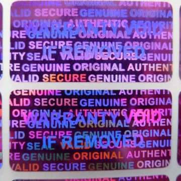 Purple 0.60in x1.20in (15mm x 30 mm) serial # TAMPER EVIDENT SECURITY VOID HOLOGRAM LABELS